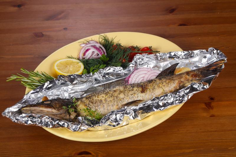 Stuffed baked pike with lemon royalty free stock images