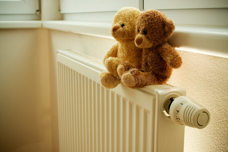 Stuffed bears on radiator stock photography