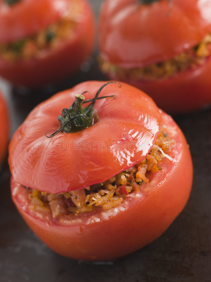 Stuffed Beef Tomato on a Baking Sheet royalty free stock images