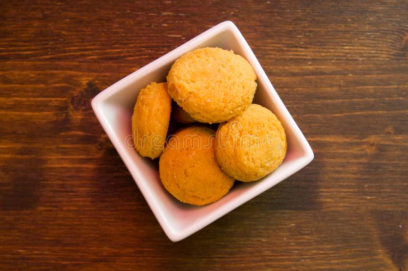 Stuffed biscuits on square bowl on wood viewed from above stock photo