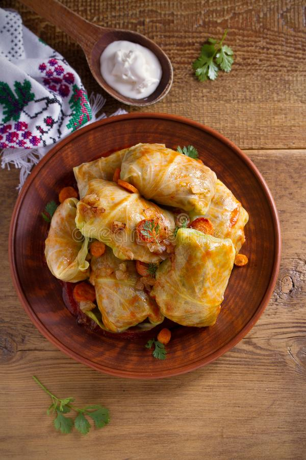 Stuffed cabbage leaves with meat, rice and vegetables. Chou farci, dolma, sarma, sarmale, golubtsy or golabki - popular dish in ma. Ny countries. overhead stock image