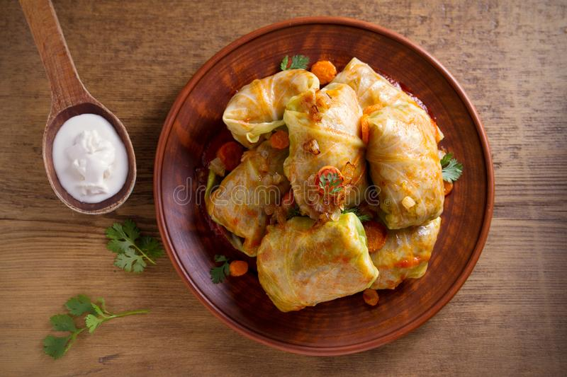 Stuffed cabbage leaves with meat, rice and vegetables. Chou farci, dolma, sarma, sarmale, golubtsy or golabki - popular dish in ma. Ny countries. overhead royalty free stock photography