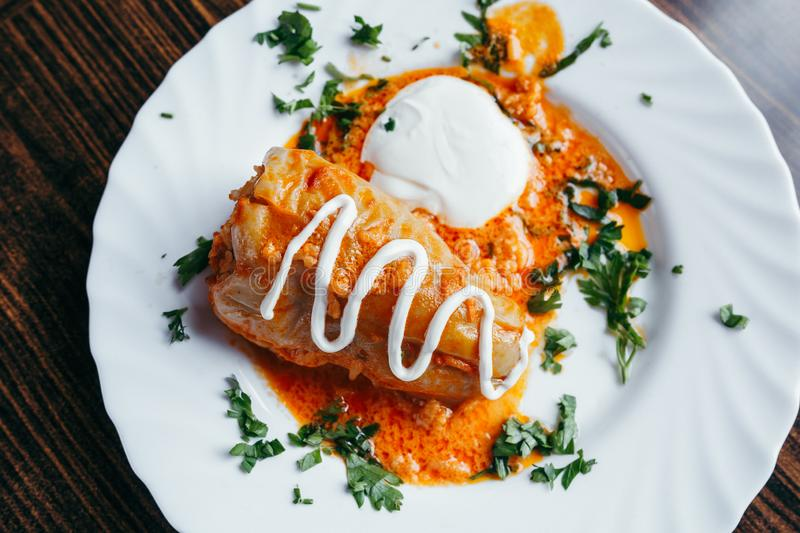 Stuffed cabbage leaves with meat, rice and vegetables. Chou farci, dolma, sarma, sarmale, golubtsy or golabki - popular dish in. Many countries. View from above stock image