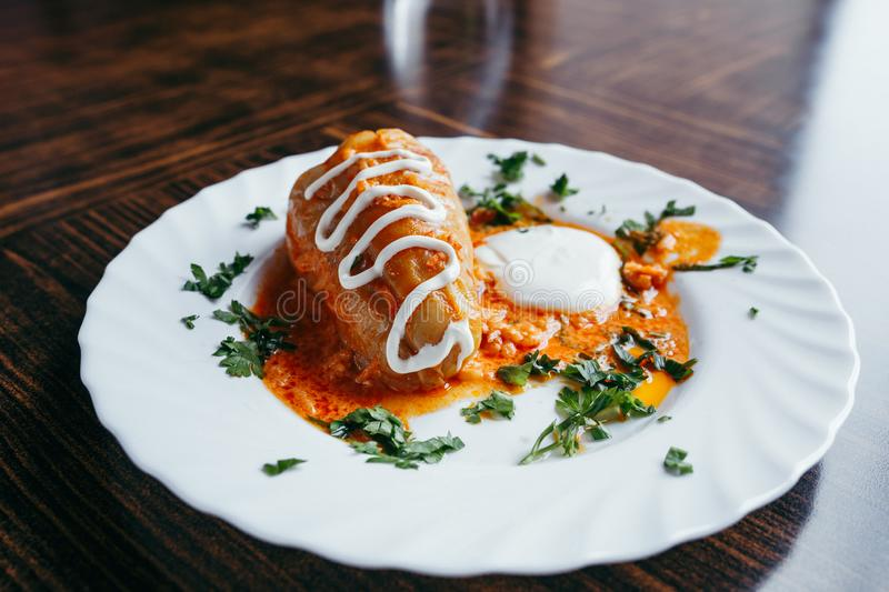 Stuffed cabbage leaves with meat, rice and vegetables. Chou farci, dolma, sarma, sarmale, golubtsy or golabki - popular. Dish in many countries. View from above stock photography