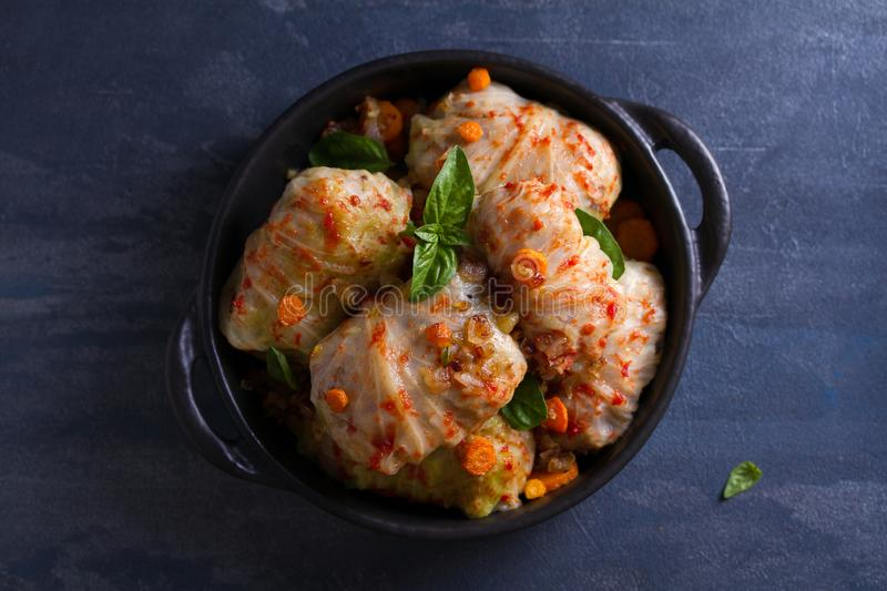Stuffed cabbage leaves with meat, rice and vegetables. Chou farci, dolma, sarma, sarmale, golubtsy or golabki - popular dish. In many countries. View from above royalty free stock image