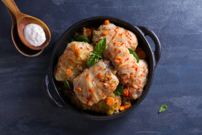 Stuffed cabbage leaves with meat, rice and vegetables. Chou farci, dolma, sarma, sarmale, golubtsy or golabki - popular dish. In many countries. View from above stock image