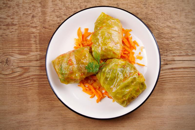 Stuffed cabbage leaves with meat, rice and vegetables. Chou farci, dolma, sarma, sarmale, golubtsy or golabki. Popular dish in many countries. overhead stock images
