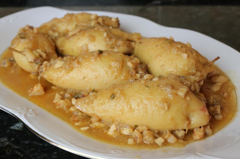 Stuffed calamari a plate of typical and traditional Andalusian and Spanish food stock photo