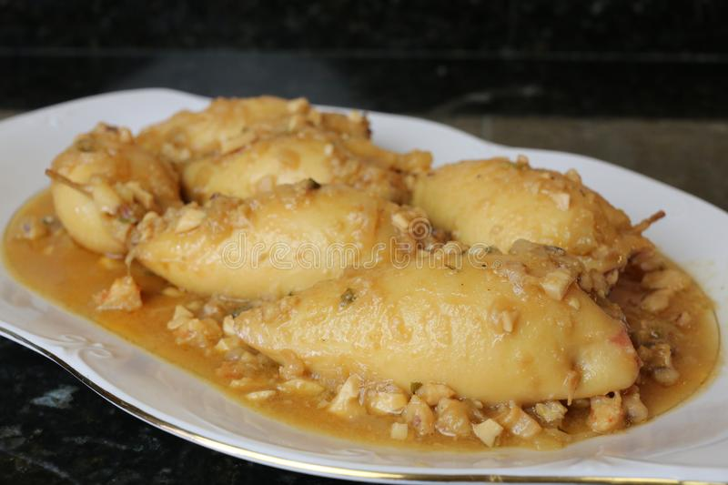 Stuffed calamari a plate of typical and traditional Andalusian and Spanish food. The stuffed calamari is a typical and traditional dish of Andalusian and Spanish stock photos
