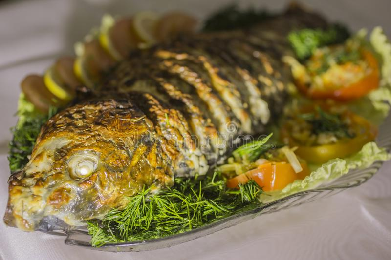 Stuffed carp, decorated with vegetables. Fish dish. stock photography