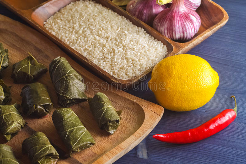 Stuffed delicious dolma with ingredients and lemon on wooden Board stock photos