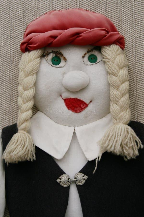 Stuffed female doll stock image