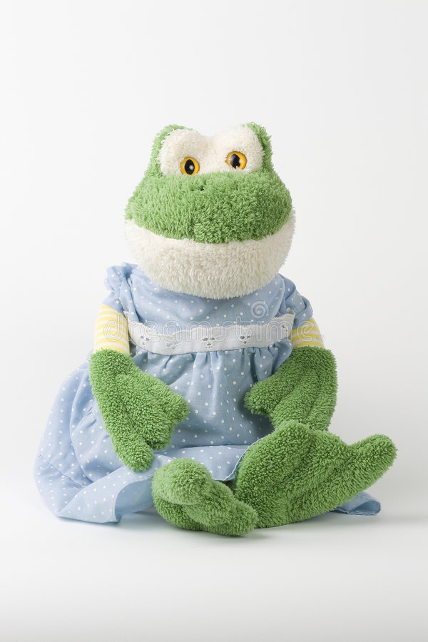 Stuffed frog in blue dress stock photography