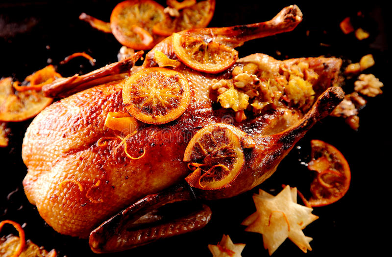 Stuffed glazed roast Christmas duck stock images