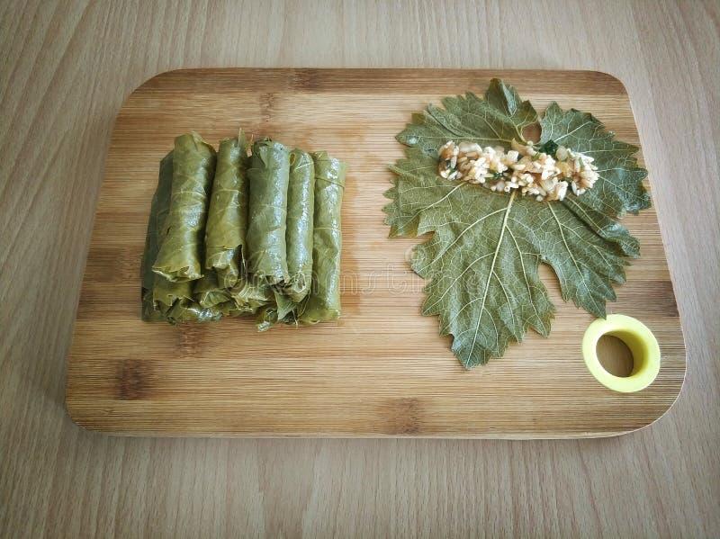 Stuffed grape leaves, turkish food sarma. On wood stock photos