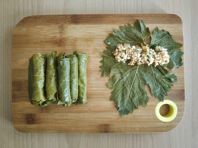 Stuffed grape leaves, turkish food sarma. On wood royalty free stock photos