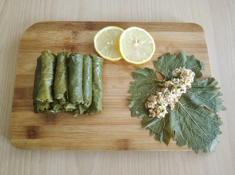 Stuffed grape leaves, turkish food sarma. On wood royalty free stock photo