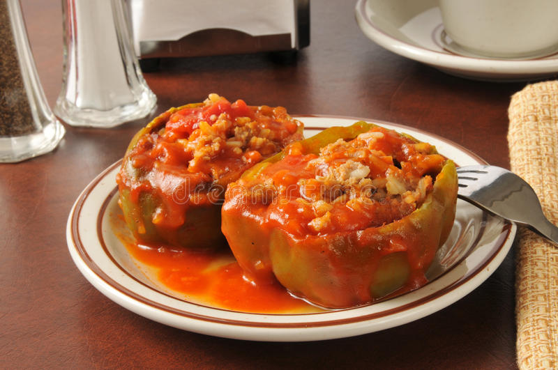 Stuffed Green Peppers. Green bell peppers stuffed with ground beef, rice and tomato sauce royalty free stock photography