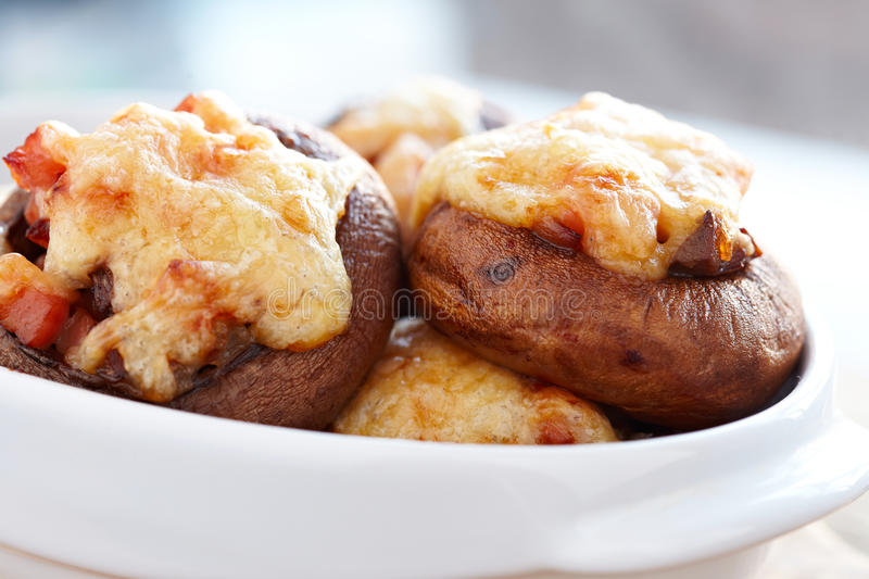 Stuffed mushrooms. Baked with ham, cheese and onion royalty free stock photos
