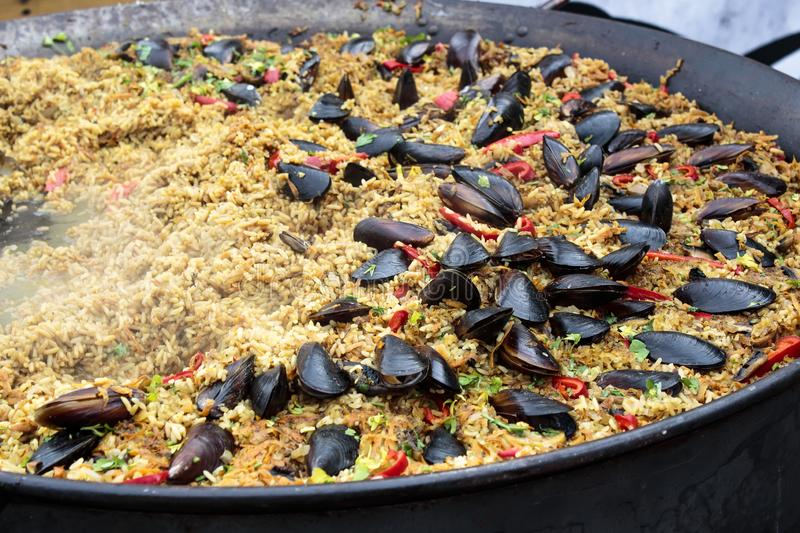 Stuffed mussels in a sauce with fresh vegetables. stock photo