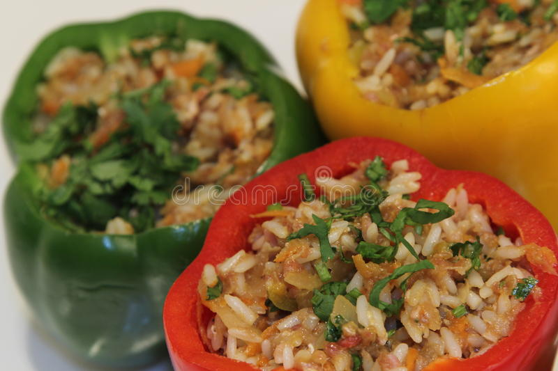 Stuffed peppers. Filled with rice, ground beef, onion, parsley, and spices. This flavorful dish is found in many variations in the Balkans, Southeastern Europe royalty free stock photography