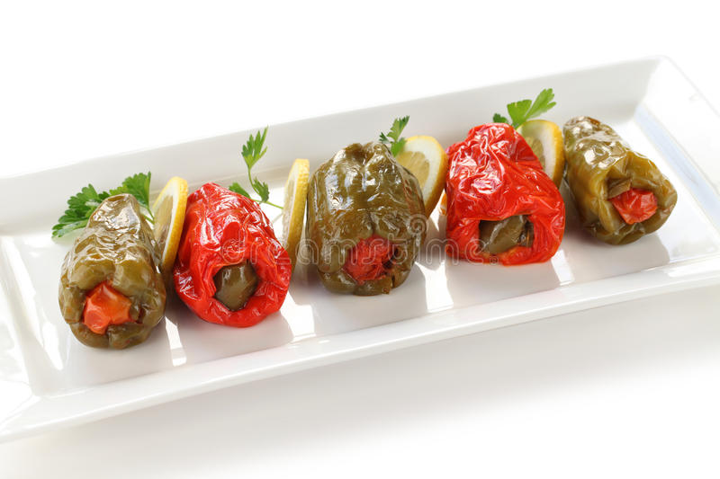 Biber dolmasi, turkish food. Stuffed peppers with rice on a white background royalty free stock image