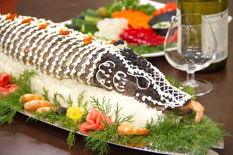 Stuffed pike on the served table royalty free stock image