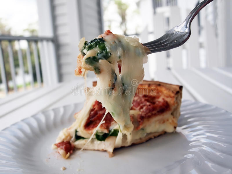Stuffed pizza & fork 3 stock image