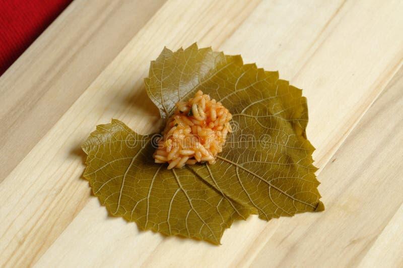Stuffed leaves - preparation royalty free stock image