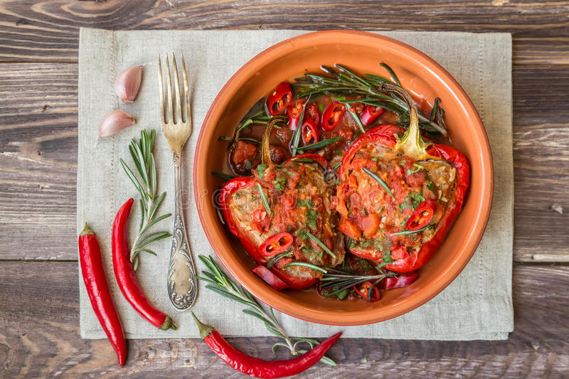 Stuffed red peppers with spicy tomato sauce and rosemary stock photography