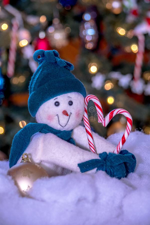 Stuffed snowman and candy cane heart royalty free stock photography