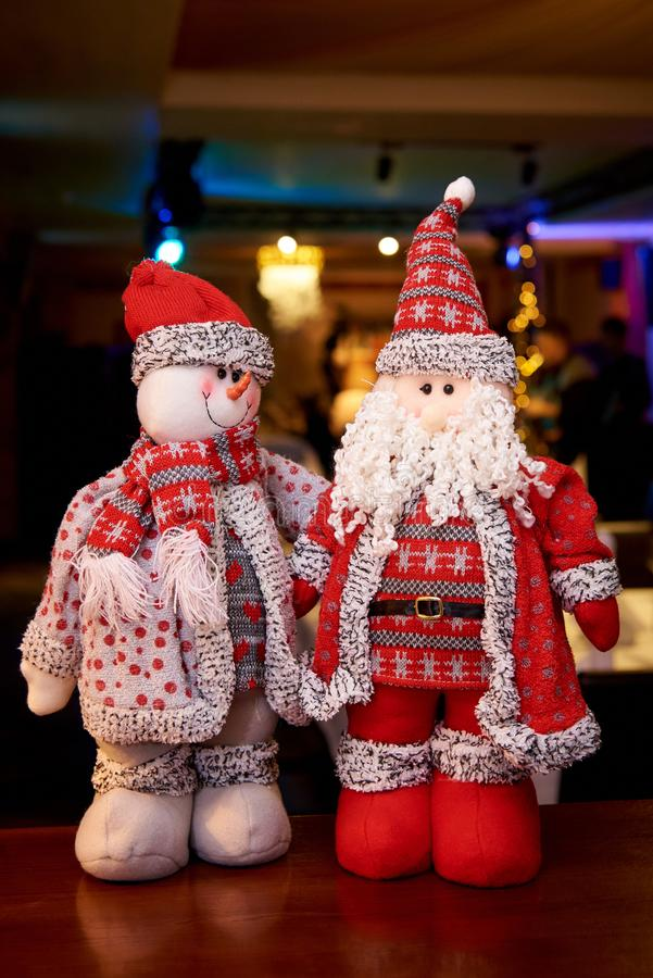 Stuffed soft Santa Claus and snowman royalty free stock image