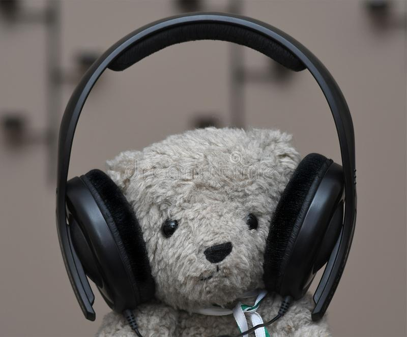 Download Stuffed Teddy Bear With Headphones Stock Image - Image of black, music: 113106769