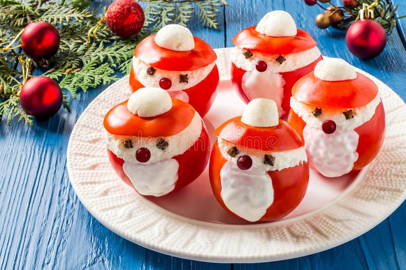 Stuffed tomatoes in form of Santa Claus for Christmas royalty free stock photos
