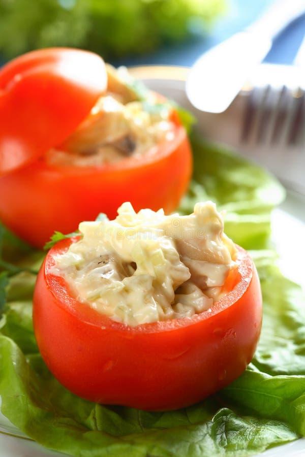Stuffed tomatoes on the salad stock photos