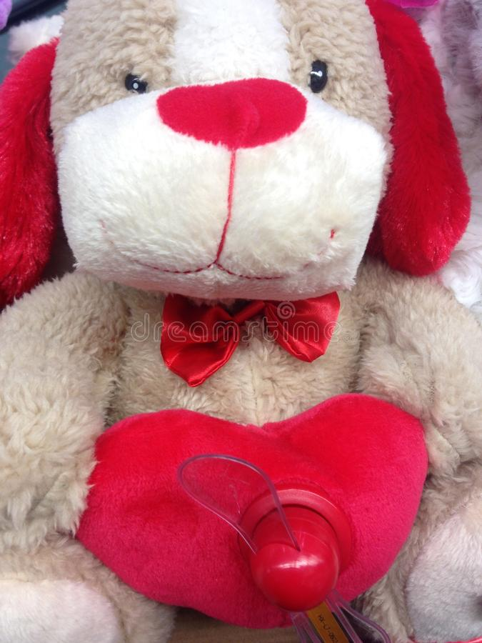 A Stuffed Toy Bear. A Stuffed Toy White Bear with Heart and Propeller royalty free stock images