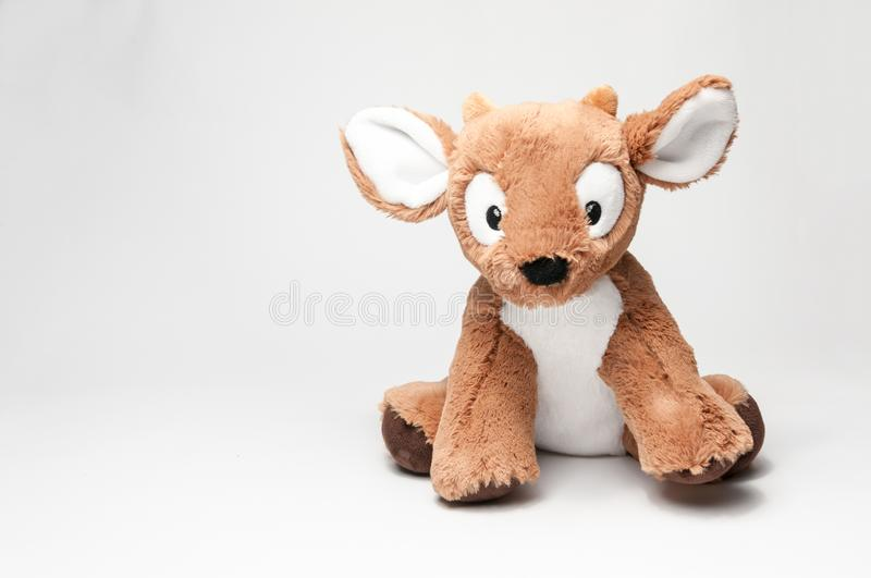 Stuffed toy Deer. On a white background royalty free stock photography