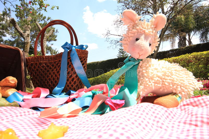Stuffed toy on a picnic royalty free stock image