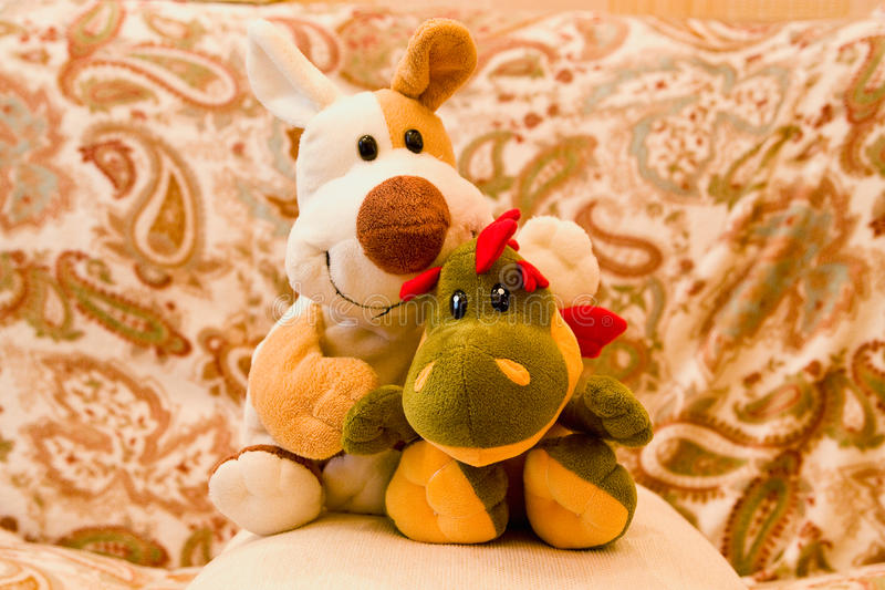 Stuffed Toys. Funny stuffed toys in sofa pillow royalty free stock photo