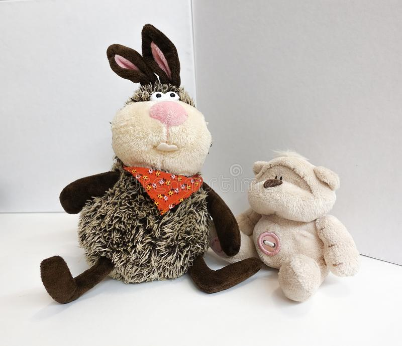Stuffed Toys. Hare and bear teddy. On a white background royalty free stock photo