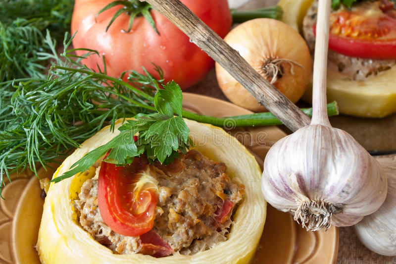 Stuffed a vegetable marrow. Still-life with stuffed a vegetable marrow and fresh vegetables royalty free stock photography