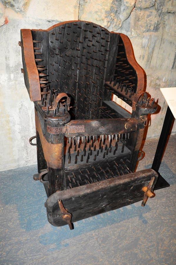 Stuhl der Folterung lizenzfreie stockfotos