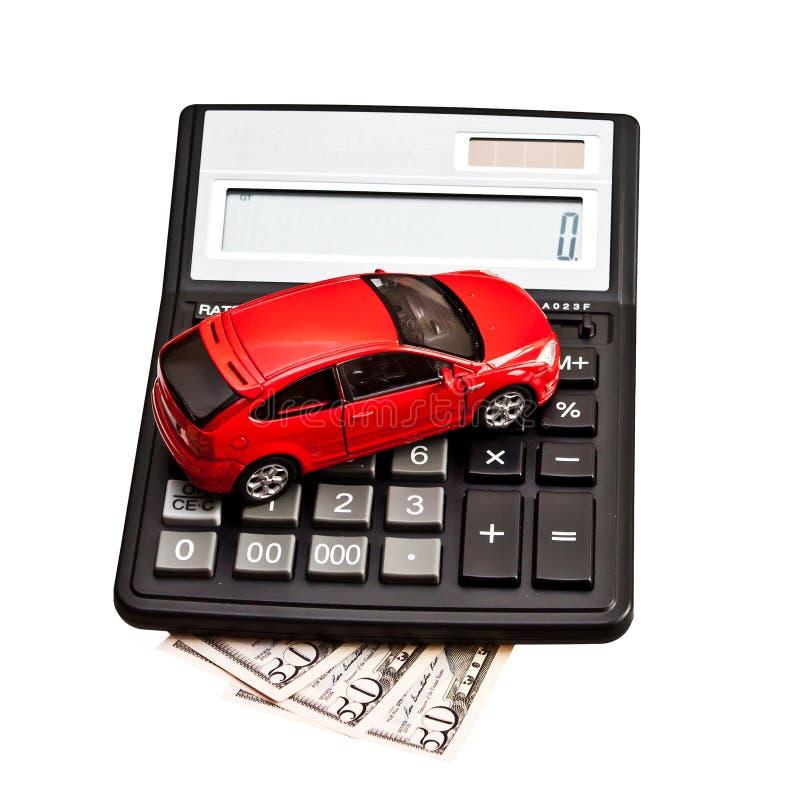 Stuk speelgoed auto en calculator over wit stock afbeeldingen