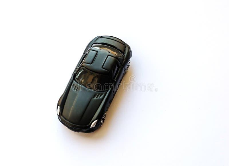 Stuk speelgoed auto op een witte achtergrond stock foto's