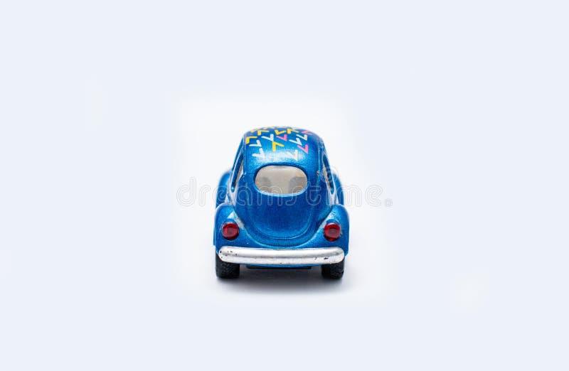 Stuk speelgoed auto op een witte achtergrond royalty-vrije stock foto's