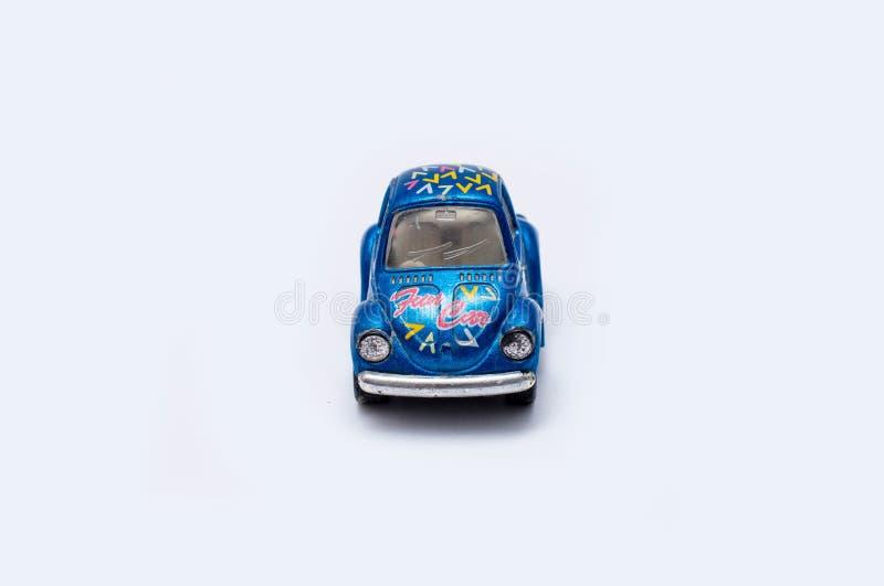 Stuk speelgoed auto op een witte achtergrond royalty-vrije stock foto