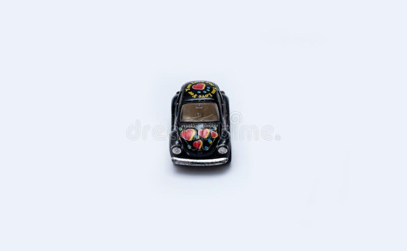 Stuk speelgoed auto op een witte achtergrond stock afbeeldingen