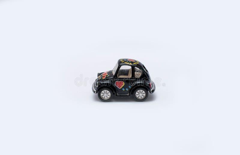 Stuk speelgoed auto op een witte achtergrond stock foto