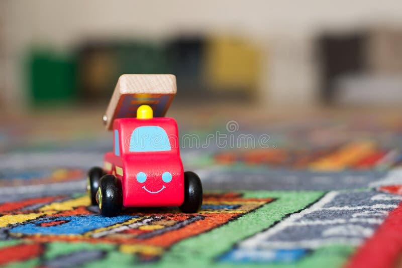 Stuk speelgoed de auto van de brandmotor stock foto