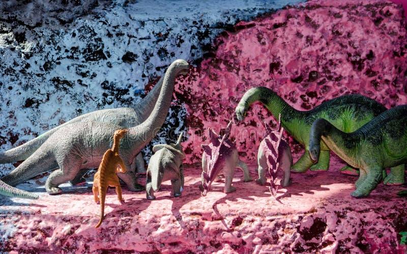 Stuk speelgoed dinosaurussenvertoning royalty-vrije stock foto's